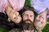 Blonde And Brunette Lay On His Shoulders. Man Fall In Love Both Women. Happy Threesome. Man Bearded  poster