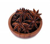 Chinese Star Anise Seed In Chinese Star Anise Seed In Wooden Bowl Over The White Background poster