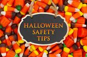 Halloween Safety Tips Message With Candy Corn On A Hanging Retro Chalkboard poster
