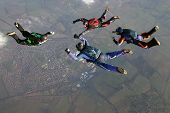 Four Skydivers Form A Formation