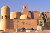 Statue Of  Mathematician Al Khoresmy With The City Walls Of Khiva In The Background, Khiva, Uzbekist poster