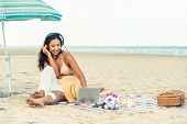 Plus Size Young Woman Sitting On The Beach. poster