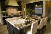 picture of model home  - Luxury home kitchen with a granite island - JPG