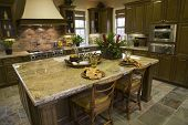 pic of home addition  - Luxury home kitchen with a granite island - JPG