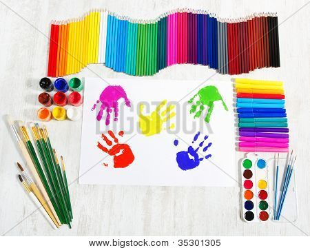 Painting Tools Set And Multicolor Child Hand Prints. Creativity Concept