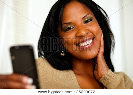 Young Woman Smiling At You While Sending A Message