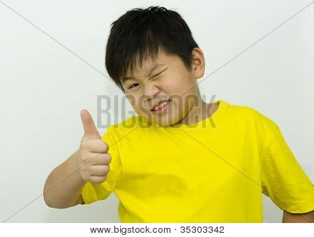 Boy With Thumbs Up Over White Background