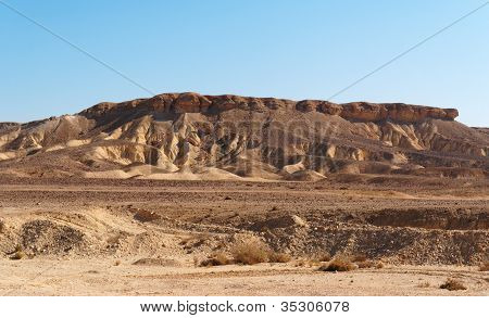 Scenic weathered yellow hill in stone desert