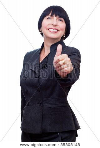 Mature business woman showing thumbs up, smiling happy.