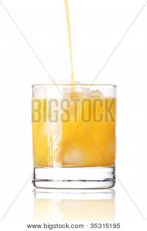 Fresh Orange Juice Pouring In To The Glassa Isolated
