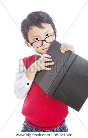 Asian Schoolboy Holding Book