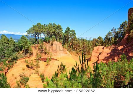 Les Ocres Du Roussillon, Footpath And Red Rocks. Provence, France