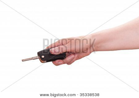 Hand Is Holding A Car Key Ahead