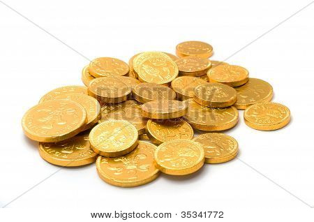 A Pile Of Chocolate Coins On A White Background.