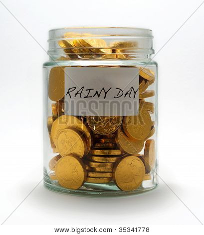 Change Jar Filled With Chocolate Coins On A White Background