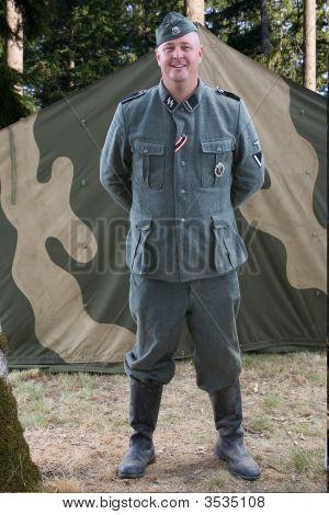 German Ss Officer  Re-Enactor Standing In Front Of Tent.