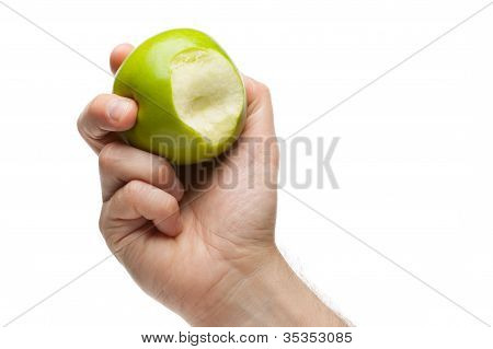 Hand Holding Green Apple With Bite Missing