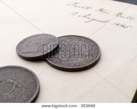 Coins On A Letter