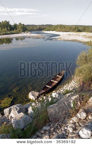 Boat On River Tied With Chain