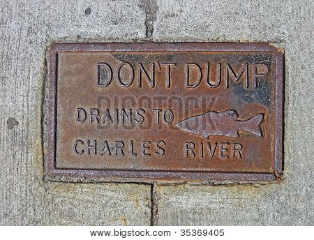 Do Not Dump Drains To Chales River As Text On Vintage Rustical Manhole, Environment