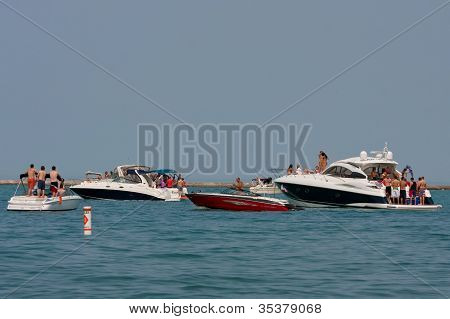 People Party On Boats In Lake Michigan