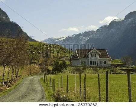 Landscape In Norway With House In Deep Valley