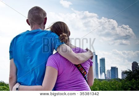 Closeup Back View Of Young Couple Admiring City Skyline