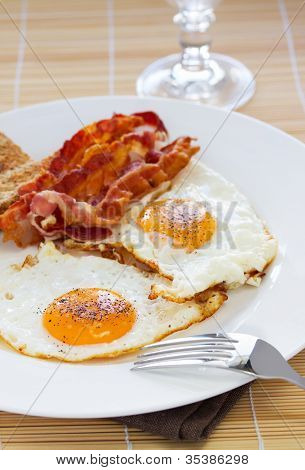 Breakfast - toasts, eggs and bacon