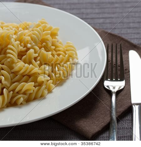 A plate with cooked pasta fusilli