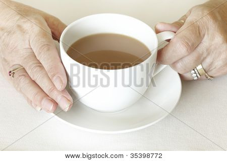 Senior Womans Hands Holding A Cup Of Tea