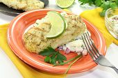 picture of hake  - Hake with lemon slice parsley chives and potato salad - JPG