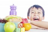 stock photo of tupperware  - Portrait of happy child with his school lunch - JPG