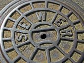 stock photo of manhole  - focus on center - JPG