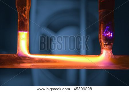 Yellow Plasma Discharge In Tube, Blue Background