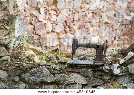 Old rusty sewing machine in destroyed Oradour sur Glane in the French Limousin