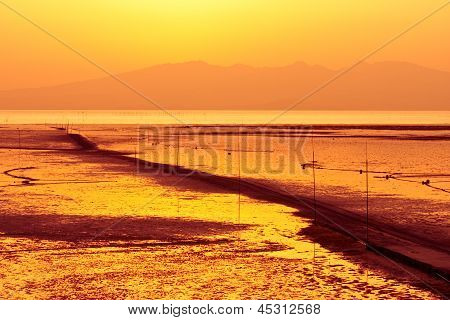 Shallow Sea Waters With Passage In Sunset