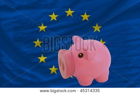 Piggy Rich Bank And  National Flag Of Europe
