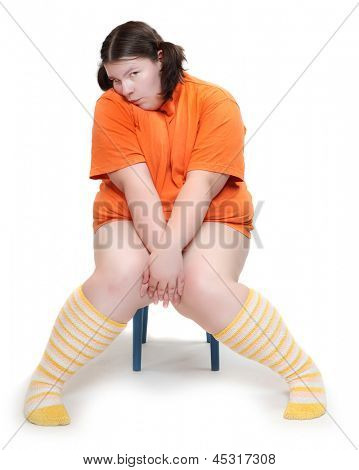 Obese school girl on a white background. Healthy lifestyle and nutrition concept.