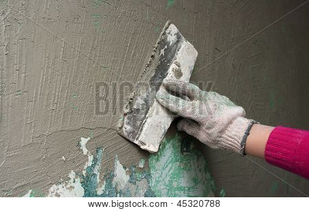 Hand With A Trowel Plaster Wall
