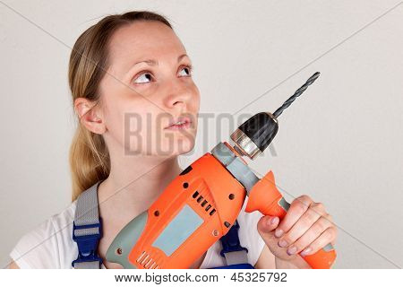Young Woman With Drilling Machine