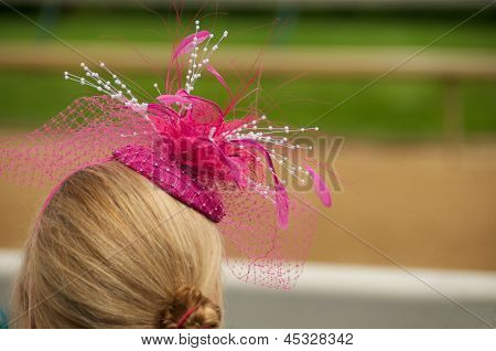 Kentucky Derby Chic: Woman in Hot Pink Fascinator Hat