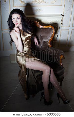 Sexy Posing Girl In Golden Dress