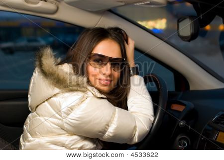 Woman In Car On A Wheel