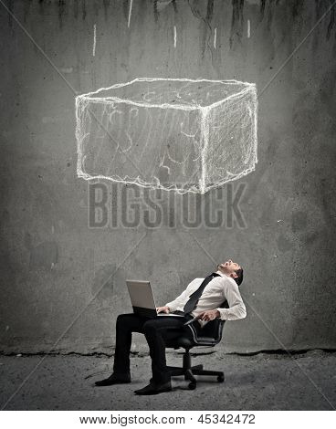 young businessman crushed by a large boulder