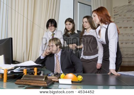 Group Of 5 Business People Working Together In The Office.