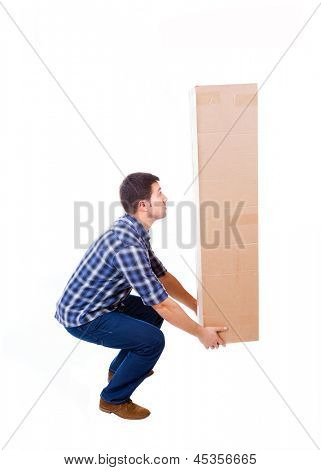 Young man lifting a cardboard box, isolated on white background