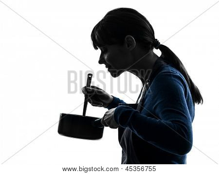 one caucasian woman cooking mixing saucepan  in silhouette studio isolated on white background