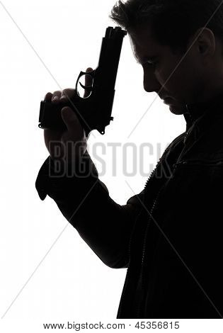 one man killer policeman holding gun portrait silhouette studio white background