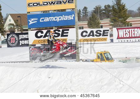 Polaris Red Snowmobile Soaring On Jump