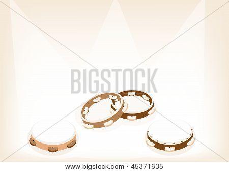 Beautiful Three Tambourine On Brown Stage Background